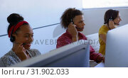 Купить «Young multi-ethnic customer sales executives talking on headset in modern office 4k», видеоролик № 31902033, снято 18 ноября 2018 г. (c) Wavebreak Media / Фотобанк Лори