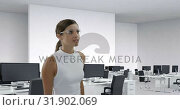Купить «Businesswoman wearing scientific glasses sliding a digital screen 4k», видеоролик № 31902069, снято 18 января 2019 г. (c) Wavebreak Media / Фотобанк Лори