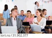 Купить «Student group having break between lessons», фото № 31902377, снято 25 июля 2018 г. (c) Яков Филимонов / Фотобанк Лори
