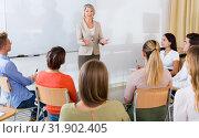 Купить «Mature female giving presentation for students», фото № 31902405, снято 19 августа 2019 г. (c) Яков Филимонов / Фотобанк Лори