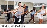 Купить «Group of multinational positive people practicing new dance techniques», фото № 31902489, снято 30 июля 2018 г. (c) Яков Филимонов / Фотобанк Лори
