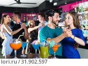 Young joyous women with men are dancing in pairs in the nightclub. Стоковое фото, фотограф Яков Филимонов / Фотобанк Лори