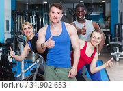 Adult people taking break during workout at gym. Стоковое фото, фотограф Яков Филимонов / Фотобанк Лори