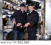 Купить «Cheerful cooks at restaurant kitchen», фото № 31902685, снято 26 октября 2018 г. (c) Яков Филимонов / Фотобанк Лори