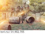 Купить «Paintball players aiming and shooting with guns», фото № 31902705, снято 22 сентября 2018 г. (c) Яков Филимонов / Фотобанк Лори