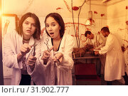 Купить «Frightened girls in escape room with traces of blood», фото № 31902777, снято 8 октября 2018 г. (c) Яков Филимонов / Фотобанк Лори