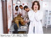 Купить «Scared girl in quest room with bloody traces», фото № 31902785, снято 8 октября 2018 г. (c) Яков Филимонов / Фотобанк Лори