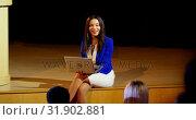 Купить «Young mixed-race businesswoman with laptop speaking in seminar at auditorium 4k», видеоролик № 31902881, снято 15 ноября 2018 г. (c) Wavebreak Media / Фотобанк Лори