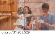 Купить «Students looking results on a library foreground», видеоролик № 31903529, снято 22 января 2019 г. (c) Wavebreak Media / Фотобанк Лори