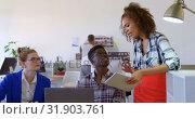 Купить «Front view of multi-ethnic business colleagues discussing over digital tablet in modern office 4k 4k», видеоролик № 31903761, снято 18 ноября 2018 г. (c) Wavebreak Media / Фотобанк Лори