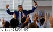 Купить «Businessman celebrating his success in the business seminar 4k», видеоролик № 31904897, снято 21 ноября 2018 г. (c) Wavebreak Media / Фотобанк Лори