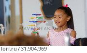 Купить «Front view of Asian schoolgirl explaining about dna structure model in the classroom 4k», видеоролик № 31904969, снято 17 ноября 2018 г. (c) Wavebreak Media / Фотобанк Лори