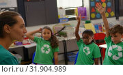 Купить «Side view of Caucasian female teacher teaching schoolkids about green energy and recycle in the clas», видеоролик № 31904989, снято 17 ноября 2018 г. (c) Wavebreak Media / Фотобанк Лори