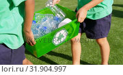 Купить «Mid section of schoolkids carrying plastic bottles waste  in the school playground 4k», видеоролик № 31904997, снято 17 ноября 2018 г. (c) Wavebreak Media / Фотобанк Лори