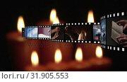 Купить «Film strip and candles», видеоролик № 31905553, снято 13 февраля 2019 г. (c) Wavebreak Media / Фотобанк Лори