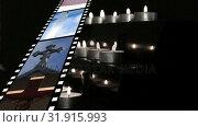 Купить «Film strip and candles», видеоролик № 31915993, снято 13 февраля 2019 г. (c) Wavebreak Media / Фотобанк Лори