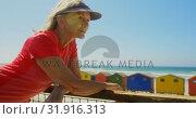 Купить «Side view of active senior Caucasian woman standing on a promenade at beach 4k», видеоролик № 31916313, снято 14 ноября 2018 г. (c) Wavebreak Media / Фотобанк Лори
