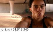 Купить «Front view of young African American woman exercising in the city 4k», видеоролик № 31918345, снято 5 декабря 2018 г. (c) Wavebreak Media / Фотобанк Лори
