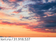 Купить «Heavenly summer background. Beautiful bright majestic dramatic evening sky at sunset or sunrise orange and blue with rays. The sun shines over the horizon against the backdrop of thunder clouds», фото № 31918537, снято 28 июня 2019 г. (c) Светлана Евграфова / Фотобанк Лори