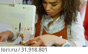 Купить «Front view of African American female fashion designer working with sewing machine in workshop 4k», видеоролик № 31918801, снято 18 ноября 2018 г. (c) Wavebreak Media / Фотобанк Лори