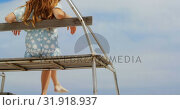 Купить «Rear view of woman sitting on observation tower on the beach 4k», видеоролик № 31918937, снято 12 ноября 2018 г. (c) Wavebreak Media / Фотобанк Лори