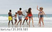 Купить «Group of mixed-race friends dancing together on the beach 4k», видеоролик № 31919181, снято 12 ноября 2018 г. (c) Wavebreak Media / Фотобанк Лори