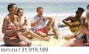 Купить «Group of mixed-race friends interacting with each other on the beach 4k», видеоролик № 31919189, снято 12 ноября 2018 г. (c) Wavebreak Media / Фотобанк Лори