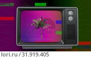 Купить «Retro television with palm tree on screen with sizzle», видеоролик № 31919405, снято 5 марта 2019 г. (c) Wavebreak Media / Фотобанк Лори