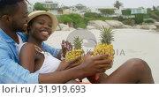 Купить «Side view of African american couple interacting with each other on the beach 4k», видеоролик № 31919693, снято 12 ноября 2018 г. (c) Wavebreak Media / Фотобанк Лори