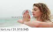 Купить «Side view of Caucasian woman performing yoga on the beach 4k», видеоролик № 31919945, снято 12 ноября 2018 г. (c) Wavebreak Media / Фотобанк Лори
