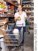 Купить «Woman customer in build store», фото № 31920117, снято 20 сентября 2018 г. (c) Яков Филимонов / Фотобанк Лори