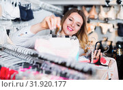 Woman client choosing brassiere in underwear store. Стоковое фото, фотограф Яков Филимонов / Фотобанк Лори