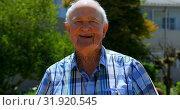 Front view of Active Caucasian senior man standing in the garden of nursing home 4k. Стоковое видео, агентство Wavebreak Media / Фотобанк Лори