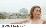 Купить «Front view of Caucasian woman performing yoga on the beach 4k», видеоролик № 31920897, снято 12 ноября 2018 г. (c) Wavebreak Media / Фотобанк Лори