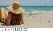 Купить «Rear view of Caucasian woman in hat relaxing on the beach 4k», видеоролик № 31921021, снято 12 ноября 2018 г. (c) Wavebreak Media / Фотобанк Лори