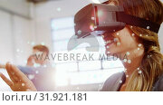 Купить «Happy female using virtual reality headset», видеоролик № 31921181, снято 5 марта 2019 г. (c) Wavebreak Media / Фотобанк Лори