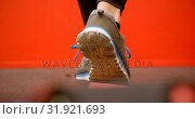 Купить «Woman doing balancing exercise in fitness studio 4k», видеоролик № 31921693, снято 26 июня 2018 г. (c) Wavebreak Media / Фотобанк Лори