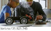 Купить «Father and daughter using soldering iron on car 4k», видеоролик № 31921745, снято 2 июня 2018 г. (c) Wavebreak Media / Фотобанк Лори