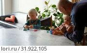 Купить «Father and children playing together with clay in a comfortable home 4k», видеоролик № 31922105, снято 28 мая 2018 г. (c) Wavebreak Media / Фотобанк Лори