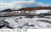 Купить «Beautiful river and snowy landscape during winter 4k», видеоролик № 31922145, снято 28 марта 2018 г. (c) Wavebreak Media / Фотобанк Лори