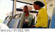 Купить «Twin sisters interacting with each other in the bus 4k », видеоролик № 31922181, снято 6 мая 2018 г. (c) Wavebreak Media / Фотобанк Лори