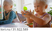 Купить «Kids playing with clay in a comfortable home 4k», видеоролик № 31922589, снято 28 мая 2018 г. (c) Wavebreak Media / Фотобанк Лори