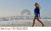 Купить «Woman walking on beach in the sunshine 4k», видеоролик № 31922653, снято 12 декабря 2018 г. (c) Wavebreak Media / Фотобанк Лори