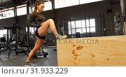 Купить «Woman exercising in fitness studio 4k», видеоролик № 31933229, снято 26 июня 2018 г. (c) Wavebreak Media / Фотобанк Лори