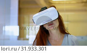 Купить «Businesswoman using virtual reality headset in a modern office 4k », видеоролик № 31933301, снято 21 февраля 2018 г. (c) Wavebreak Media / Фотобанк Лори