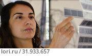 Купить «Female photographer checking film strips at photo studio 4k», видеоролик № 31933657, снято 14 июня 2018 г. (c) Wavebreak Media / Фотобанк Лори