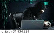 Купить «Sneaky hacker working on two computers», видеоролик № 31934821, снято 26 марта 2019 г. (c) Wavebreak Media / Фотобанк Лори