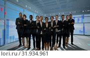 Купить «Business people standing in a room with graphs», видеоролик № 31934961, снято 27 марта 2019 г. (c) Wavebreak Media / Фотобанк Лори