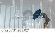 Купить «Businesswoman holding an umbrella against a storm 4k», видеоролик № 31935021, снято 5 апреля 2019 г. (c) Wavebreak Media / Фотобанк Лори
