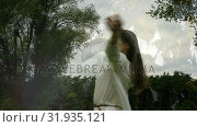 Woman in white dress spinning in a forest. Стоковое видео, агентство Wavebreak Media / Фотобанк Лори